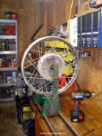Wheel in vise, ready for disassembly
